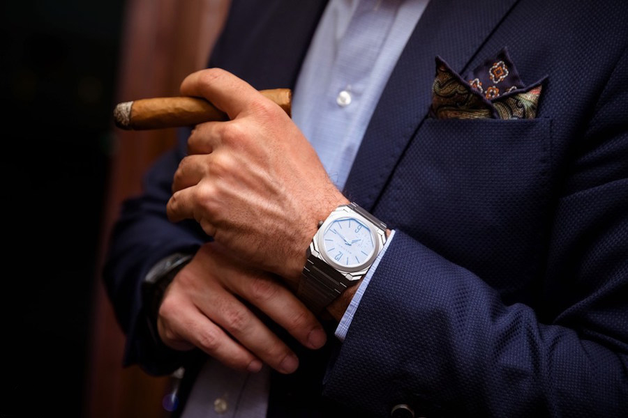 Cigar, suit and watch image for marketing with teeth