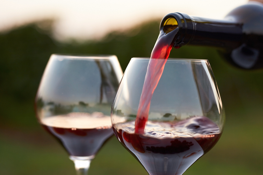 pouring wine image for marketing with teeth